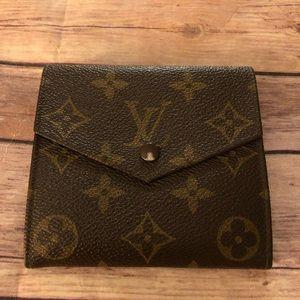 Louis Vuitton Elise trifold wallet.